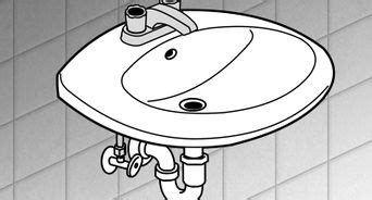 how to recaulk kitchen sink how to caulk a bathroom sink 12 steps with pictures
