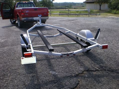 jon boat trailer rollers make a pair of bunk glides for your boat trailer 4 steps