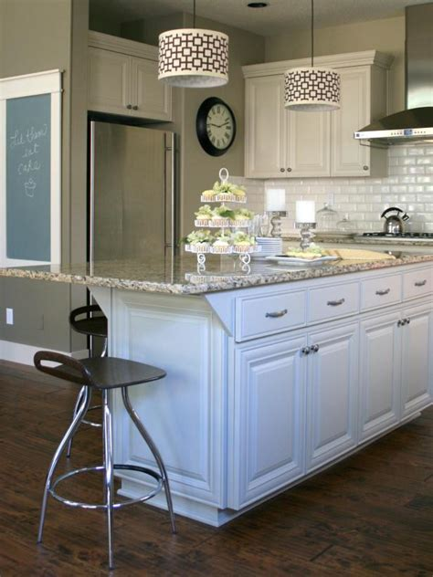 painted kitchen featuring oversized black island customize your kitchen with a painted island hgtv