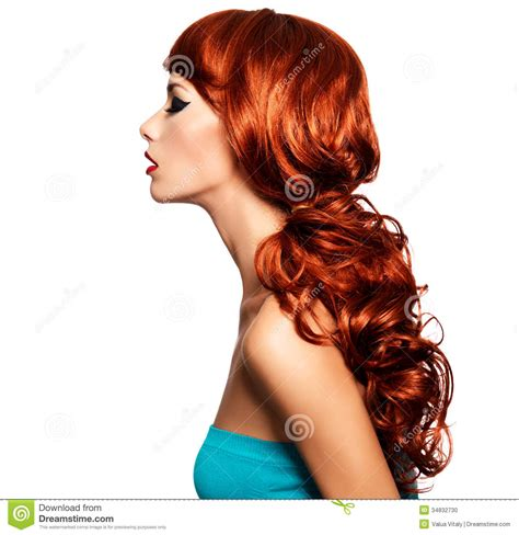 side profile of hairstyles profile portrait of a woman with long red hairs stock