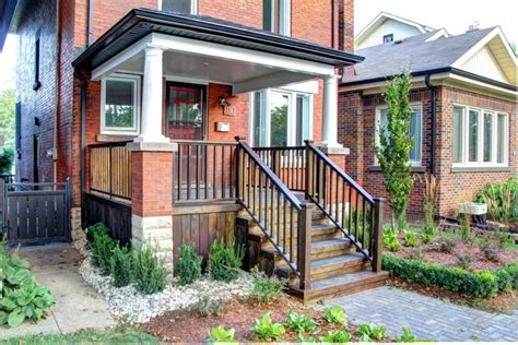 Wood Porch On Brick House classic american style wooden front porch railing in a beautiful brick house artenzo
