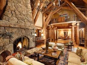 rustic great rooms rustic great room with rock fireplace chandelier