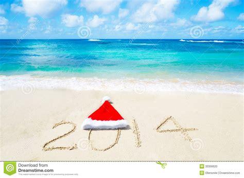 imagenes de feliz navidad en la playa numere 2014 con el sombrero de la navidad en la playa