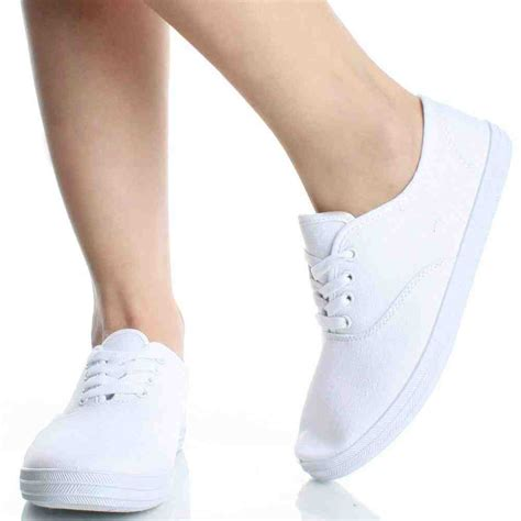 white canvas tennis shoes sport equipment