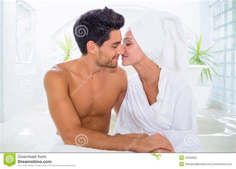 kiss bathroom attractive couple kissing in towels stock photo image