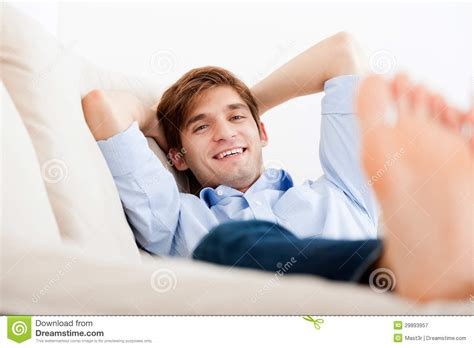 Upside Down Floor Plans by Man Lying Down On Sofa Royalty Free Stock Photography