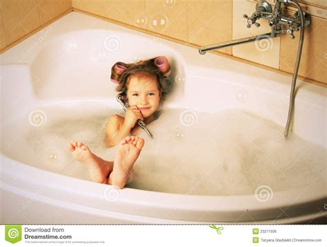 glamour little girl in the bathtub royalty free stock