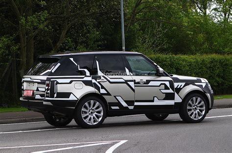 land rover camo spyshots 2013 range rover drops camo autoevolution
