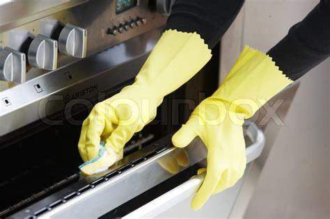 Model Kitchen Gloves With Yellow Rubber Gloves Cleaning The Oven Stock