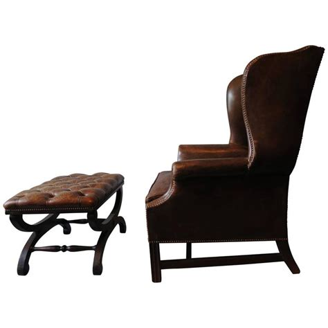 leather armchair with footstool dark brown leather chesterfield wingback armchair with