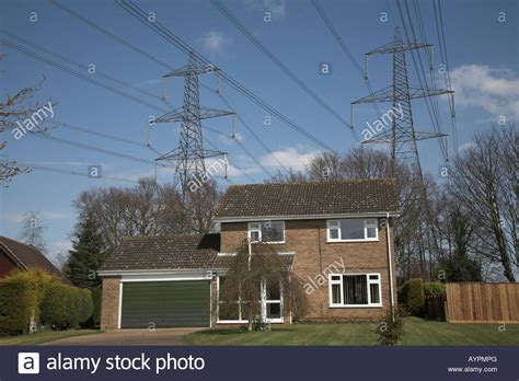 electricity power lines passing suburban houses