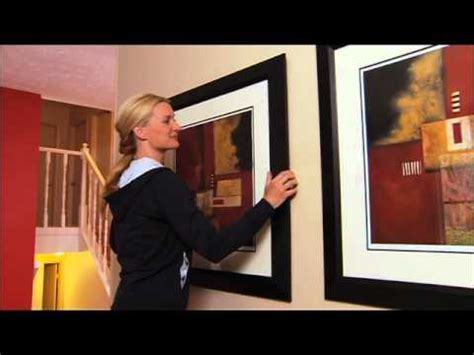 how to hang a picture frame how to hang pictures on a wall youtube