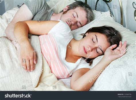 photos of husband and wife in bedroom young husband wife sleeping on bed stock photo 152966756