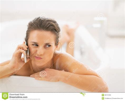 women bathtub concerned young woman in bathtub talking cell phone stock