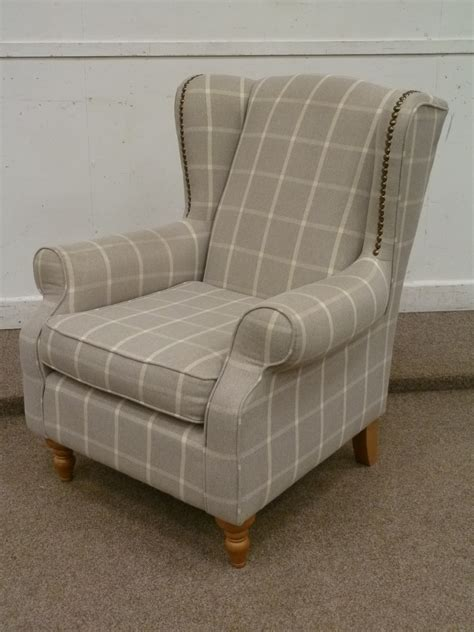 cream armchair next sherlock wingback armchair in grey and cream check cover
