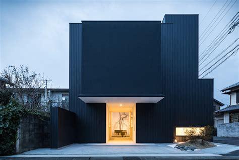 nord a minimalist japanese house inspired by religious black framing house in japan fubiz media