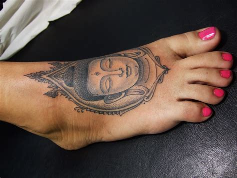 women s foot tattoos buddha on the dorsal part of a s foot
