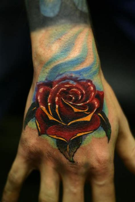 rose tattoos on the hand idealistic politics tattoos for on
