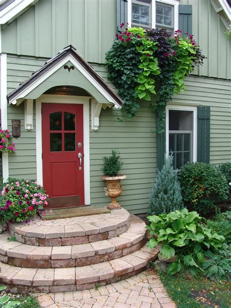 light green front door this small home s color scheme is charming the soft