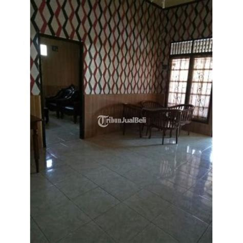 rumah griya sejahtera dinding keramik motif kayu
