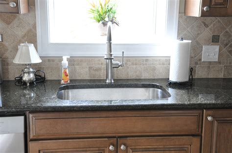kitchen backsplash ideas with uba tuba granite countertops