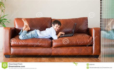 laptop on couch kid with a laptop on the couch stock photo image 9508440