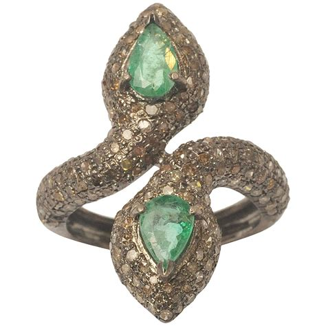 headed pear shaped emeralds with pave set diamonds