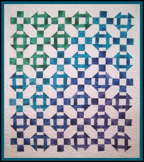 churn dash with alternating nine patch quilt patterns