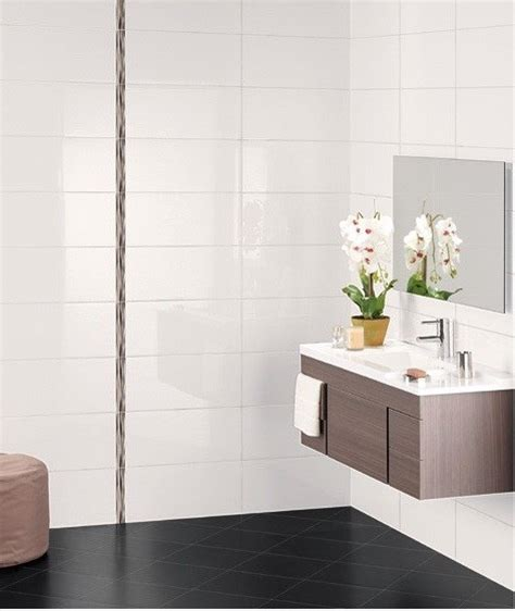 big white bathroom tiles how can i make my bathroom look bigger tips for a