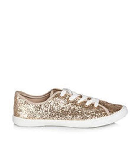 gold glitter tennis shoes on the hunt