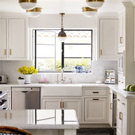 white cabinets with antique brass hardware get the look brass kitchen cabinet pulls shopper s guide