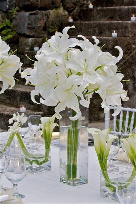 white centerpiece david tutera tropical white event flower arrangements