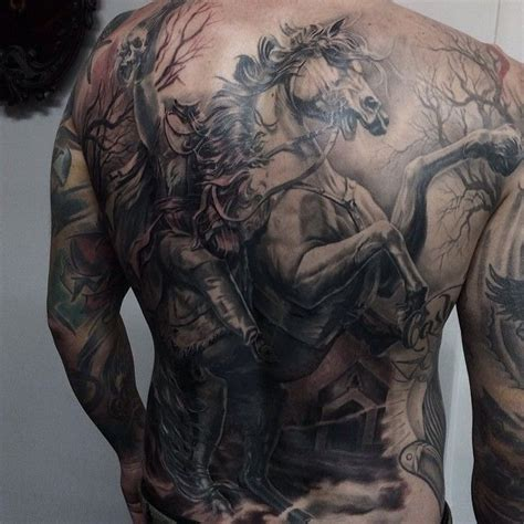 headless horseman tattoo by carlos torres tattoos
