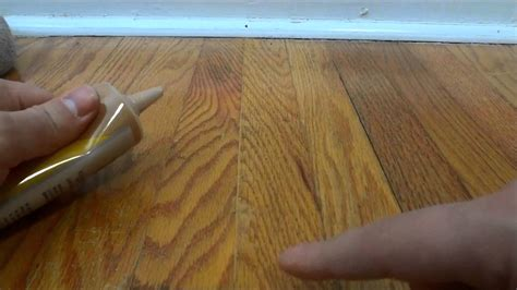 how to fill in gaps between hardwood flooring with wood