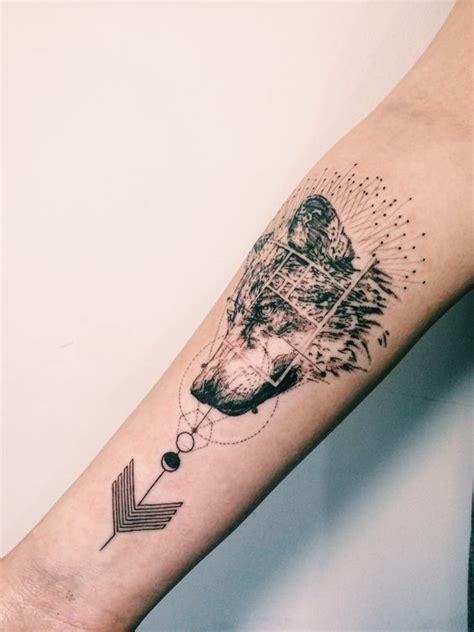 geometric tattoo in london wolf geometric arrow tattoo inked pinterest