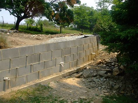 How To Build A Garden Wall On A Slope Concrete Block Retaining Wall Drainage Concrete Block