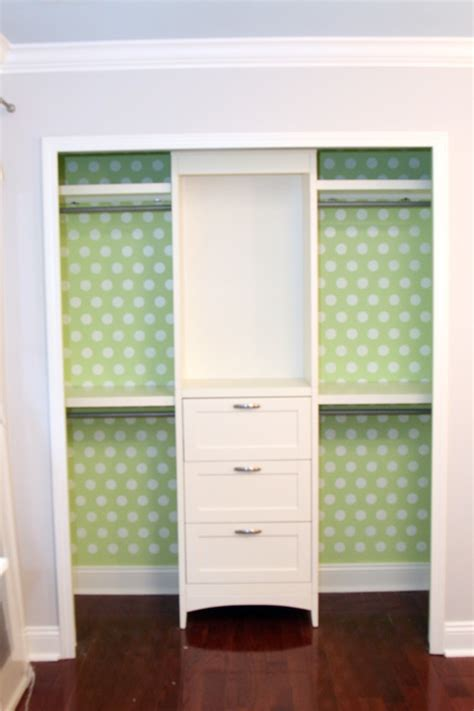 small closet chest of drawers wallpaper the back of a closet stack a bookshelf on top