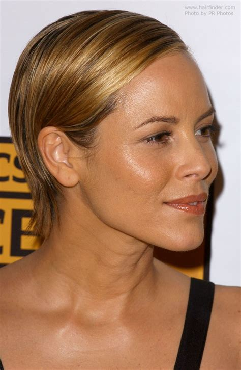 Maria Bello's chic short hairstyle with the hair combed
