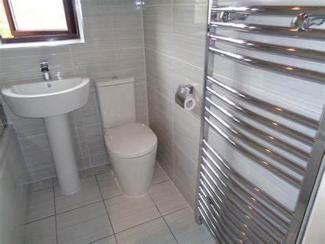 Modern Refitted Bathroom With White Grey Tiles and Chrome