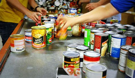 Volunteer At Food Pantry by Lending A Helping Working Poor America