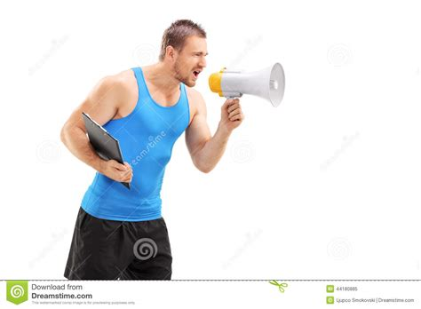 gym couch male fitness coach shouting through a megaphone stock