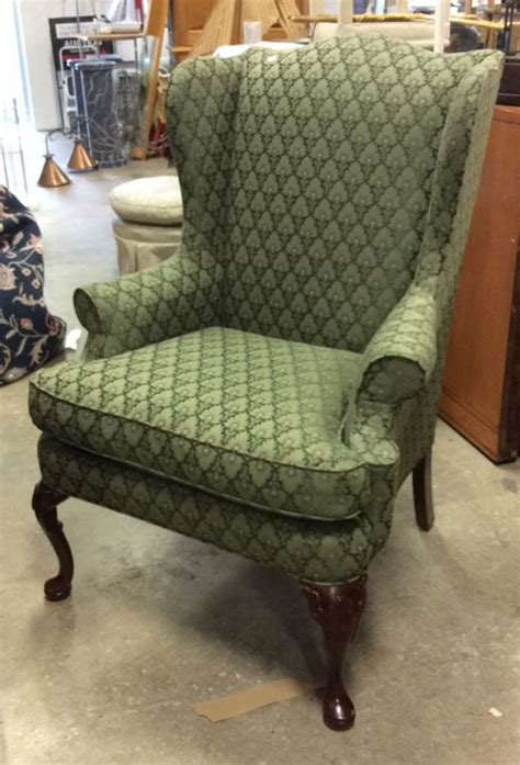 upholstered green wing chair