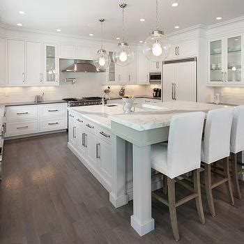 white l shaped kitchen with island gray kitchen island with white parsons bar stools