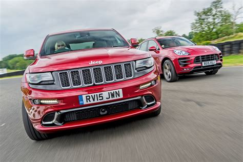 porsche jeep 2014 jeep grand srt vs porsche macan turbo auto express