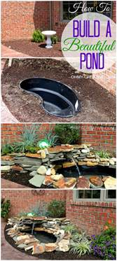 how to build a backyard garden diy backyard pond landscape water feature oh my creative