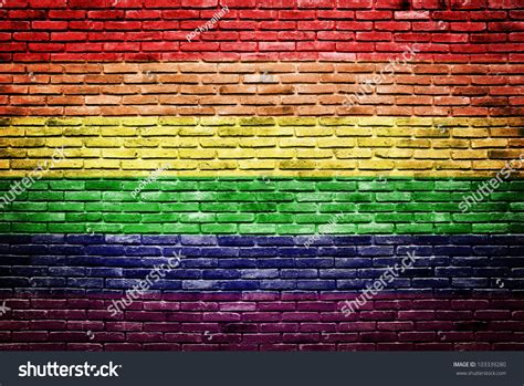 rainbow flag painted   brick stock photo