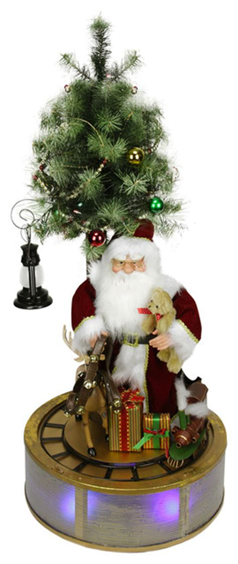 santacruz with christmas tree animated northlight seasonal animated and musical led santa claus with tree and rotating d cor