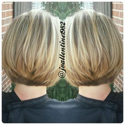 Blonde haircolor with short stacked layers cut into a bob