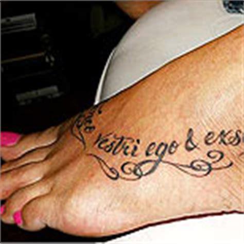 latin tattoo on foot foot tattoos