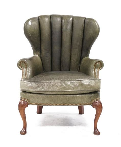green leather upholstered funnel back club chair height 41 quot